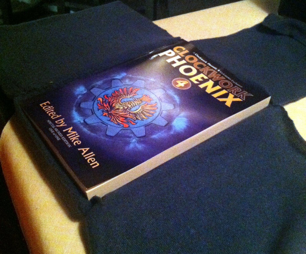 The unveiling of the special singular signed edition of CLOCKWORK PHOENIX 4 in the special padded case Anita made for it to travel in.