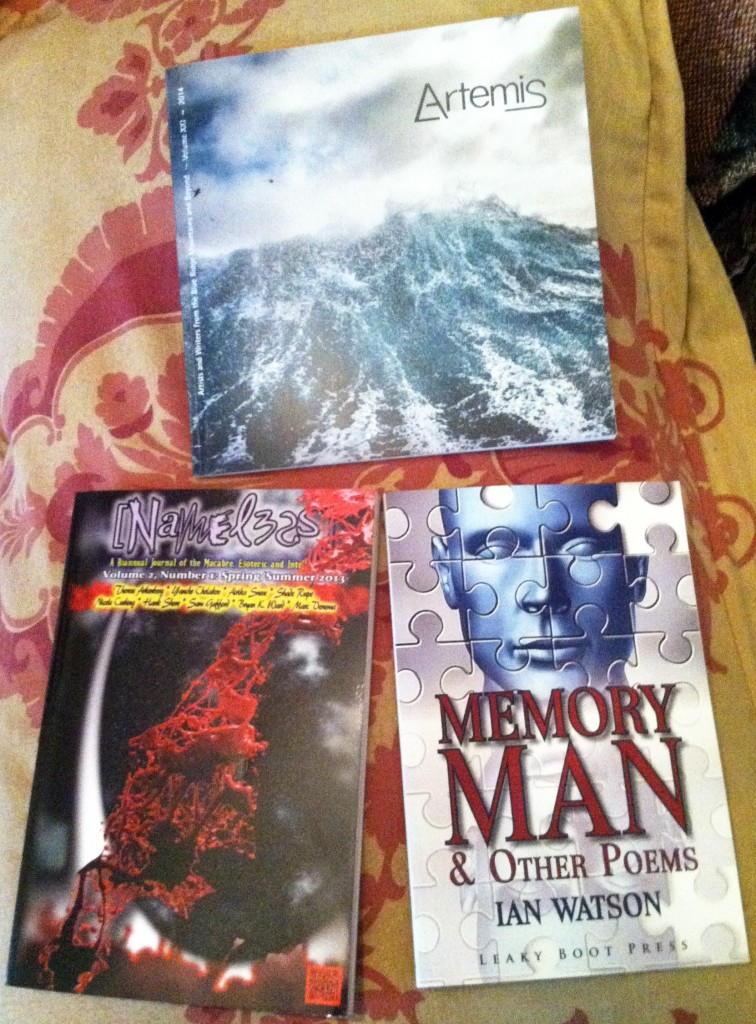 "Clockwise from top: Artemis journal, containing my poem ""A Curtain of Stars""; Memory Man by Ian Watson, which contains all seven of the poems he and I co-wrote, including our masterpiece, ""Propitiating Cthulhu""; Nameless magazine, which holds my short story ""Monster."""