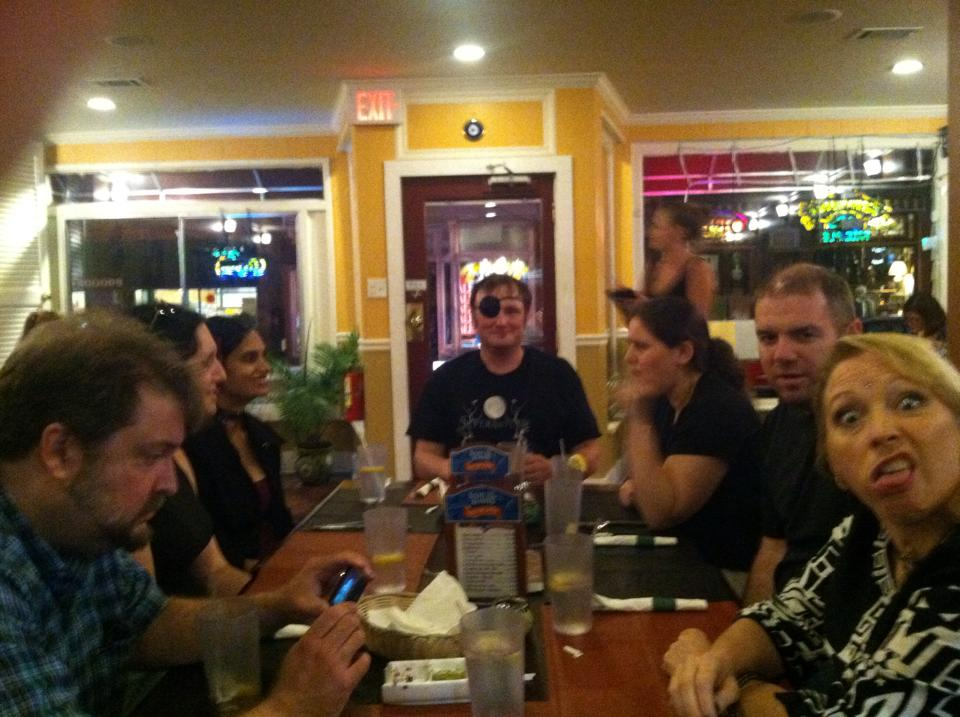 Dinner after the reading, taken with my iPhone. From left to right, John Langan, who is watching this video on Anita's phone; Nicole, Shveta, Laird, Jessica, my buddy Tim Dorsey from undergrad days at Virginia Tech(!); and Anita, expressing her opinion of my camera skills.