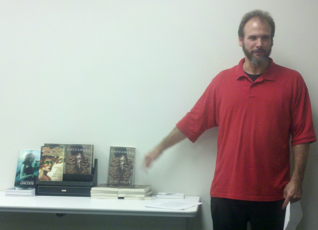 Photo by Dwayne. The gesture I'm making suggests that I was reminding folks I had books for sale, hee.